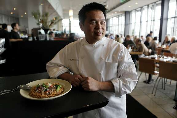 Charles Phan, on Tuesday January 26, 2010, is the founder and chef of The Slanted Door, in San Francisco, his restaurant is one of the most revered restaurants in the country. Phan a Vietnamese native left his country after the fall of Saigon coming to America with his family with nothing. The dish nearby is a Seafood with Crispy Egg Noodle.