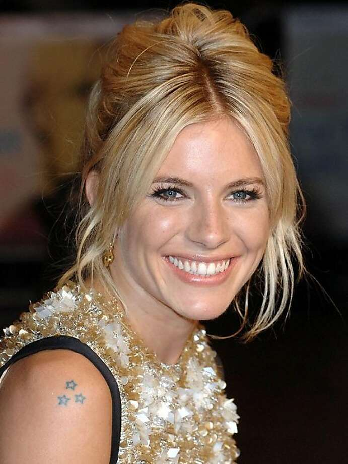 Sienna Miller sports tiny stars on her shoulder. Photo: WENN.com