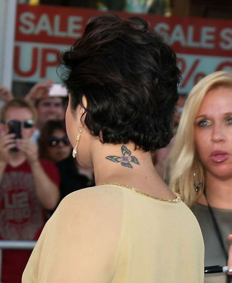 Vanessa Hudgens' new short hair reveals a butterfly tattoo at the nape of her neck. Photo: Nikki Nelson, WENN.com