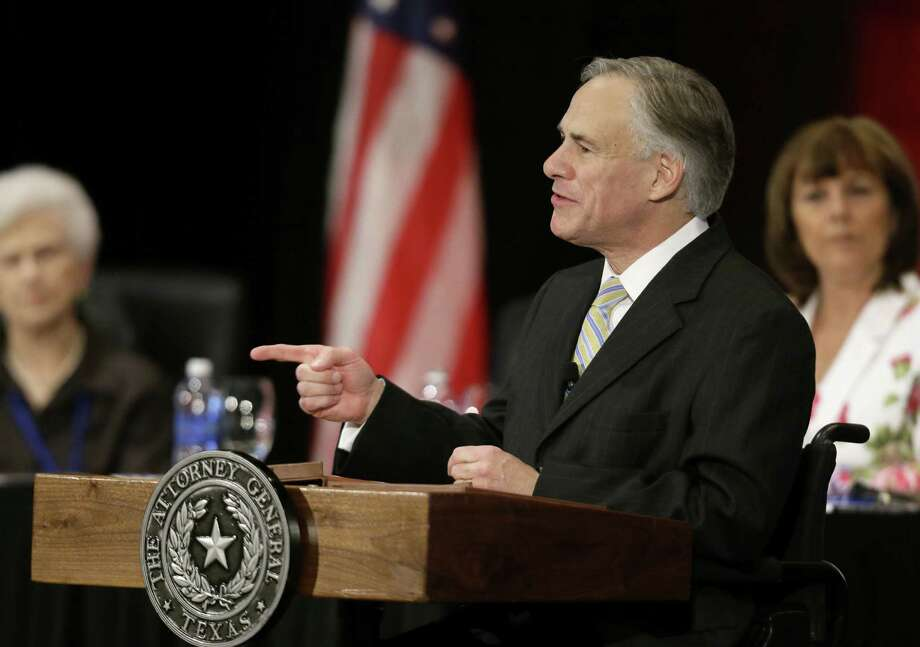 Texas Attorney General Greg Abbott has pushed hard to implement  a Voter ID law, and minority voters may feel he is trying to suppress their vote. Photo: Tony Gutierrez / Associated Press