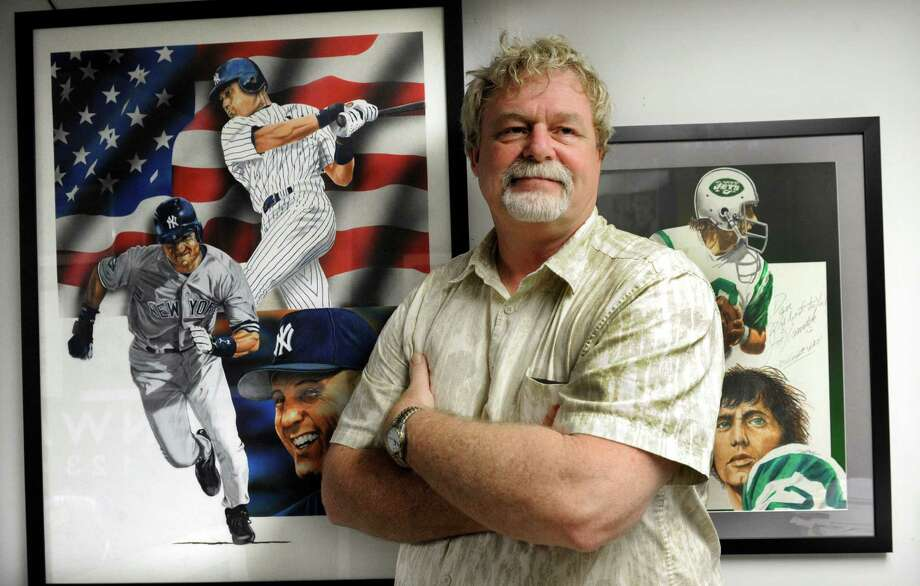 Dan McKee, owner of Designs and Signs in Brookfield, Conn., is photographed with some of his artwork in his shop Friday, July 5, 2013. McKee's paintings often feature famous sports figures such as Derek Jeter, left, and Joe Namath, right. Photo: Carol Kaliff / The News-Times