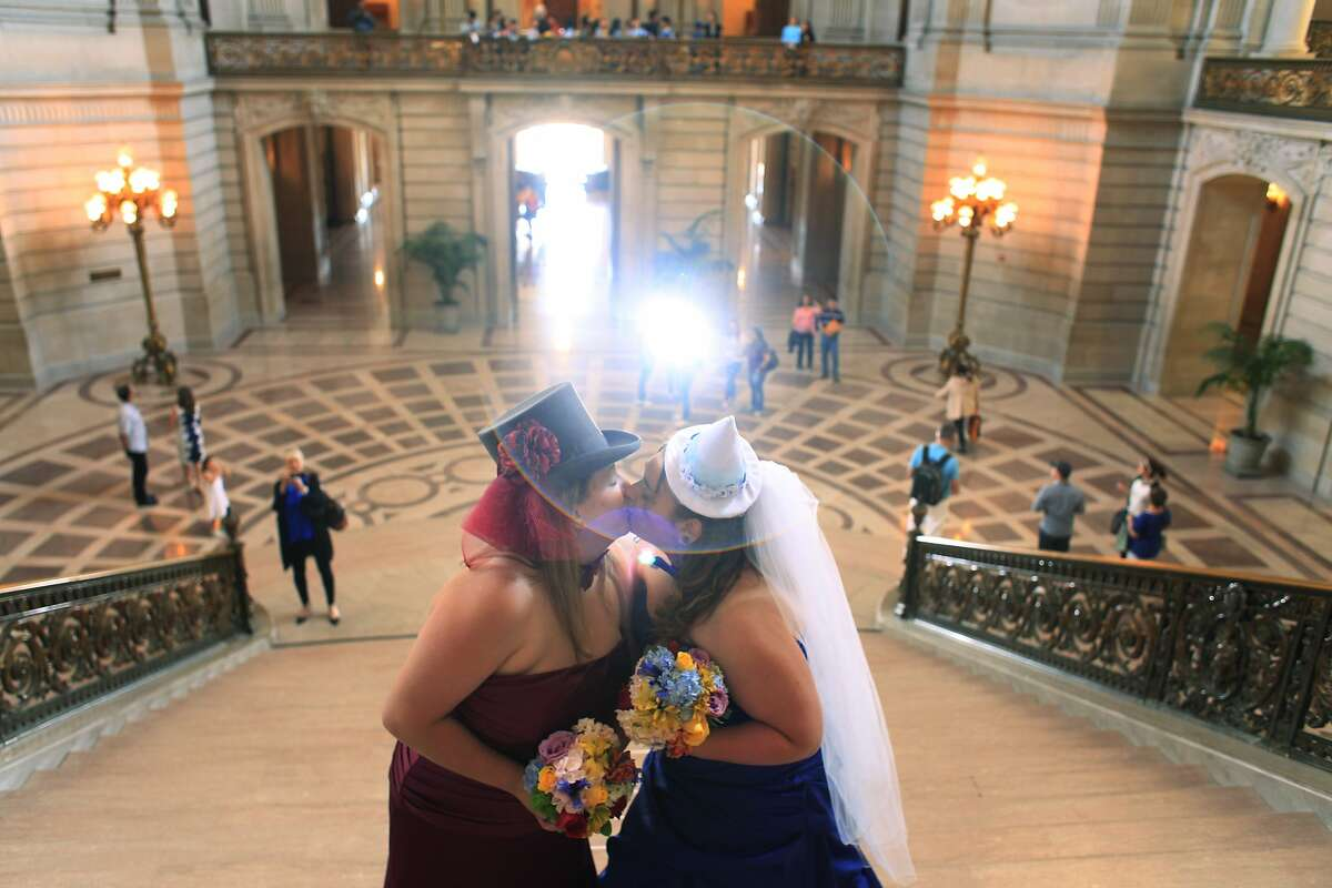 Anna Hennigh, 27, and Melody Hennigh, 26, kiss at the top of the grand staircase under the rotunda before getting married at San Francisco City Hall on Wednesday July 3, 2013.