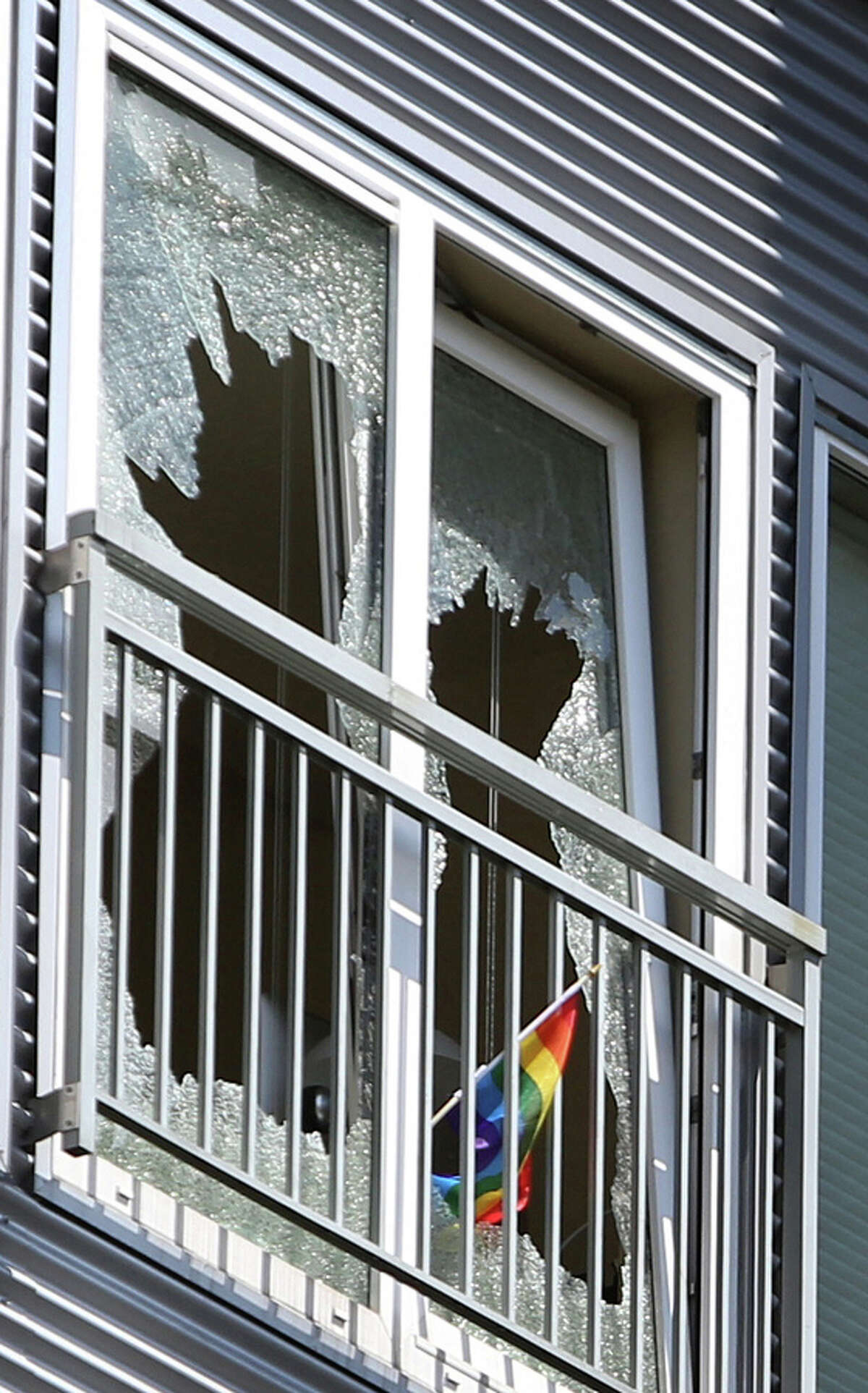 A shattered window is shown in an apartment after a standoff between an armed man and Seattle Police SWAT officers ended with the man fatally shot on Friday, July 5, 2013 in Seattle's Capitol Hill neighborhood. The man fired his gun in the direction of officers when they responded and fatally shot him.