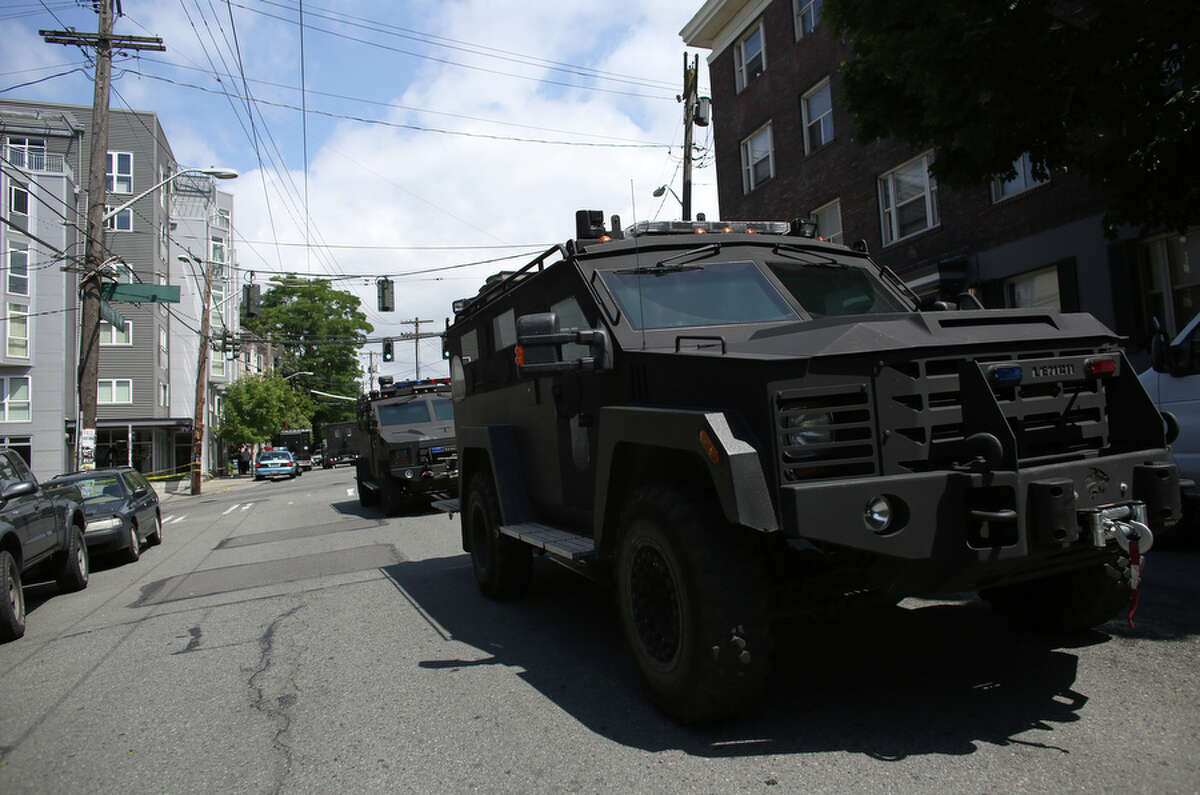 A SWAT vehicle drives past after a standoff between an armed man and Seattle Police SWAT officers ended with the man fatally shot on Friday, July 5, 2013 in Seattle's Capitol Hill neighborhood. The man fired his gun in the direction of officers when they responded and fatally shot him.