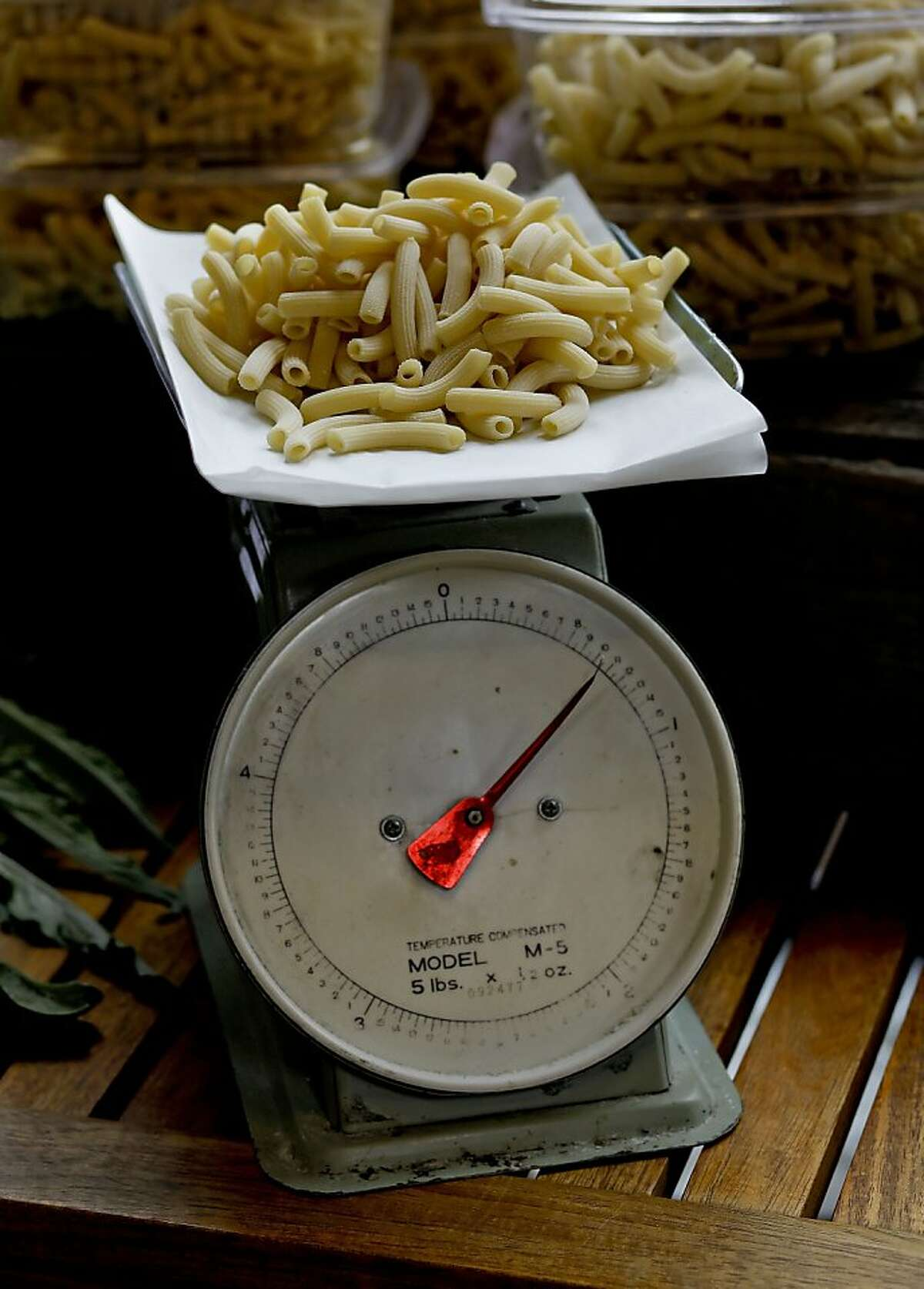 An antique scale displays the fresh hand-made pasta by chef, Samin Nosrat on Wednesday May 19, 2010, in Oakland, Calif. The Pop Up General Store features the creations of several local chefs who sell their products every couples of weeks at the Grace Baking Catering Building.