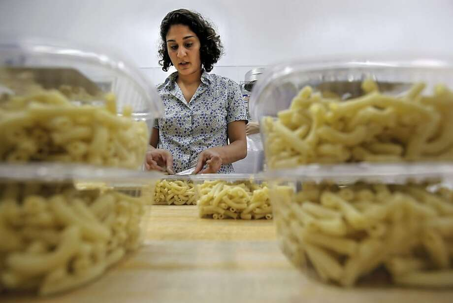 Chef Samin Nosrat packages fresh hand-made pasta she made in 2010 for the Pop Up General Store. Photo: Michael Macor, The Chronicle
