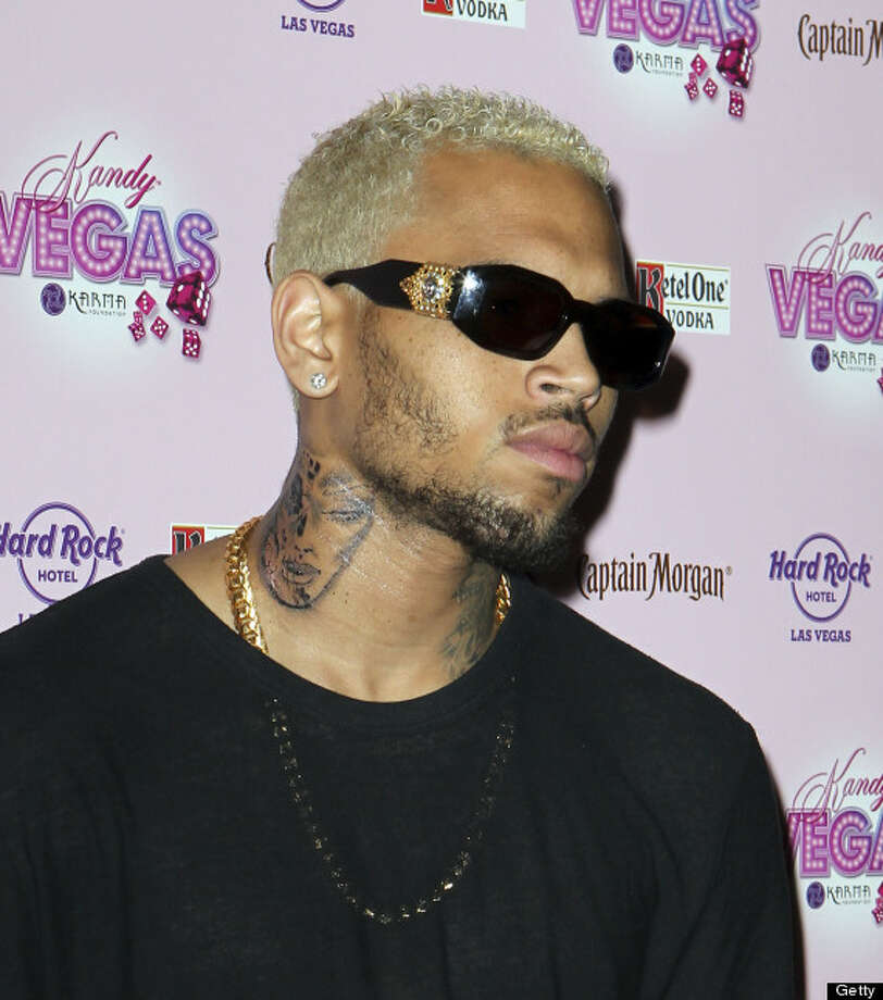 Chris Brown's new neck tattoo, which some suspect is related to his ex-girlfriend Rihanna, is the latest celebrity ink causing a buzz. Photo:  Jeff R. Bottari, Getty Images / 2012 Jeff R. Bottari