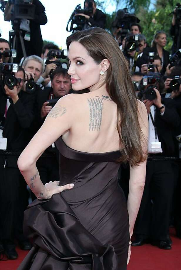 Actress Angelina Jolie is famous for her body art. Here, she shows off just a small selection of her ink. Photo: Ian Wilson, WENN.com