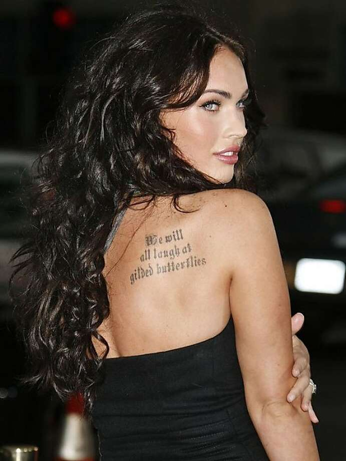 Megan Fox has a literary tattoo on her back, and perhaps more famously, a portrait of Marilyn Monroe inked on her forearm, which she is currently in the process of removing. Photo: Adriana M. Barraza, WENN.com