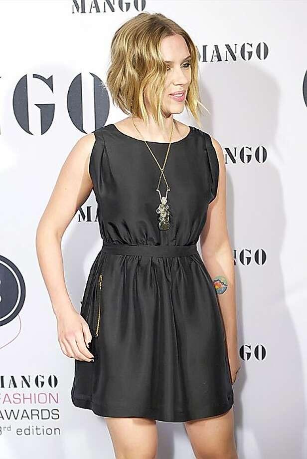 Scarlett Johansson has a colorful sunset on her inner forearm. Photo: Sean Thorton, WENN.com