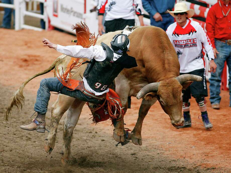 Texas has rodeos. There's nothing more American than watching a person try and stay on a bull for longer than a couple seconds. Photo: Jeff McIntosh, Associated Press / The Canadian Press