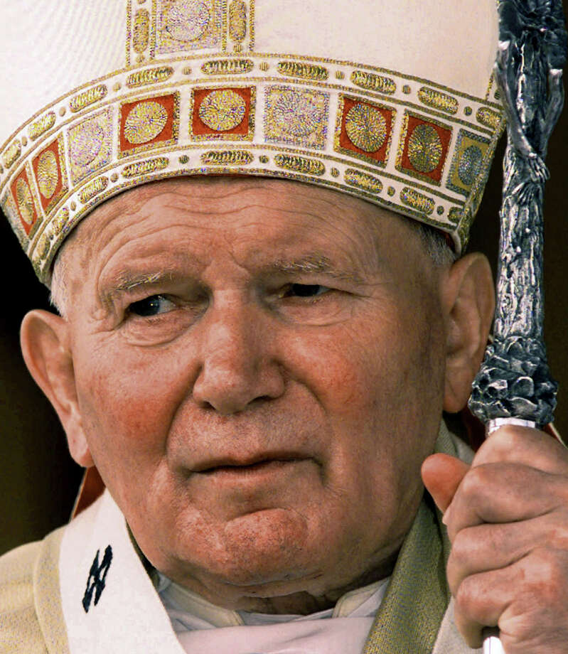 In this Jan. 22, 1998 file photo, Pope John Paul II holds his first Mass in Cuba. Pope Francis has cleared John Paul II for sainthood, approving a miracle attributed to his intercession. Francis also decided Friday, July 5, 2013, to canonize another beloved pope, John XXIII, even though there has been no second miracle attributed to his intercession. The Vatican said Francis approved a decision by cardinals and bishops. The ceremonies are expected before the end of the year. (AP Photo/Domenico Stinellis, Photo: AP, STF / AP