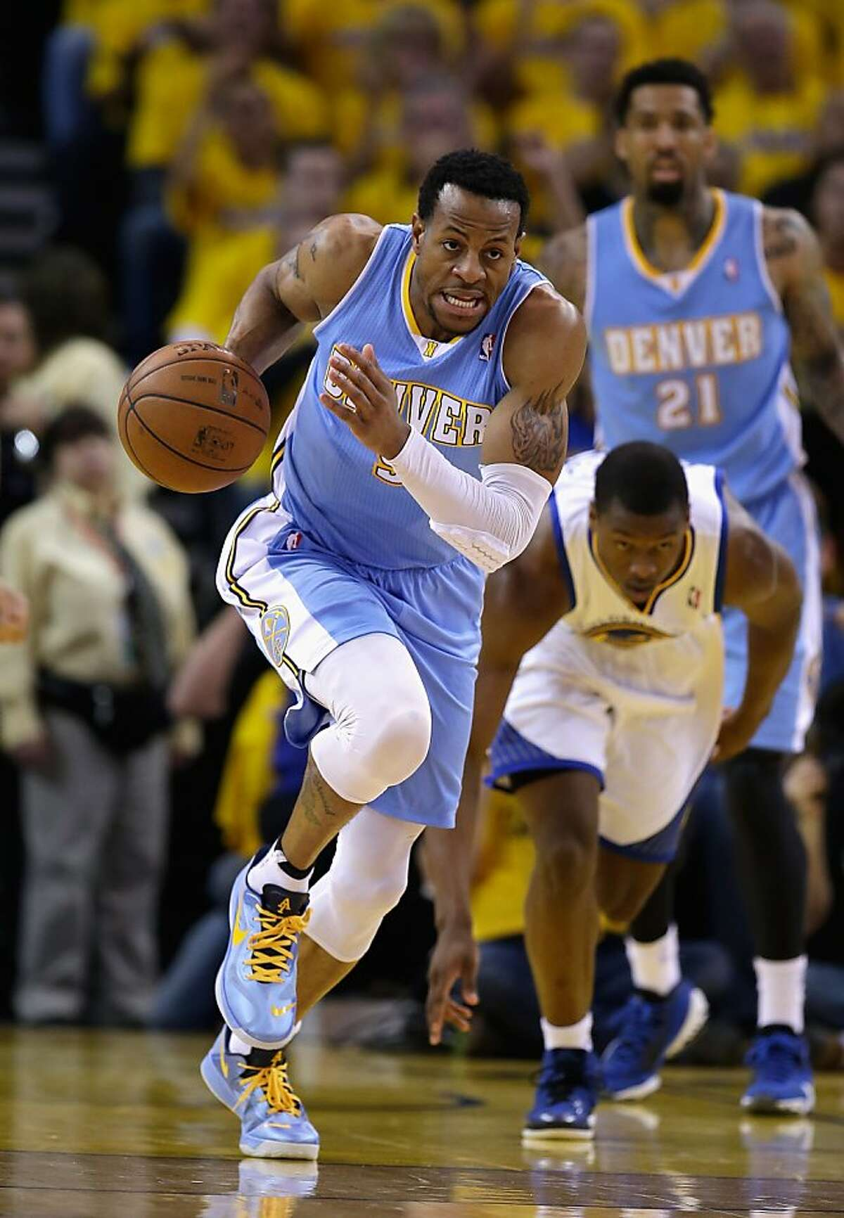 OAKLAND, CA - APRIL 26: Andre Iguodala #9 of the Denver Nuggets dribbles up court during their game against the Golden State Warriors during Game Three of the Western Conference Quarterfinals of the 2013 NBA Playoffs at ORACLE Arena on April 26, 2013 in Oakland, California. NOTE TO USER: User expressly acknowledges and agrees that, by downloading and or using this photograph, User is consenting to the terms and conditions of the Getty Images License Agreement. (Photo by Ezra Shaw/Getty Images)
