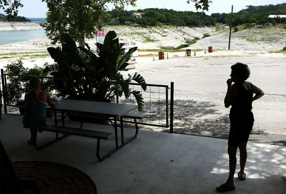 A customer at Red Cove Marina on Medina Lake looks out at the lake that is currently only 5.2% full, on Thursday, July 4, 2013. Drought conditions on Medina Lake, on Monday, July 1, 2013. The lake is currently at 5.2 percent full. Photo: Bob Owen, San Antonio Express-News / © 2012 San Antonio Express-News