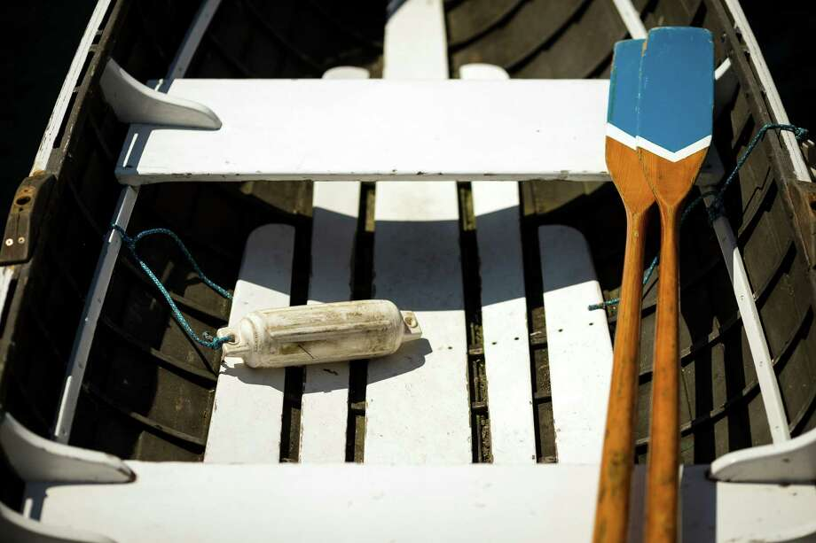 Oars sit unused in a watercraft during the 37th annual Wooden Boat Festival Friday, July 5, 2013, at The Center for Wooden Boats in South Lake Union in Seattle. The free waterfront event - which goes through Sunday - features live music, boat rides and the opportunity to build your own miniature craft. Photo: JORDAN STEAD, SEATTLEPI.COM / SEATTLEPI.COM
