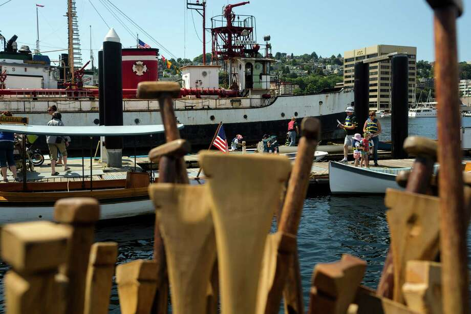 Attendees await their turn in a free boat ride at the 37th annual Wooden Boat Festival Friday, July 5, 2013, at The Center for Wooden Boats in South Lake Union in Seattle. The free waterfront event - which goes through Sunday - features live music, boat rides and the opportunity to build your own miniature craft. Photo: JORDAN STEAD, SEATTLEPI.COM / SEATTLEPI.COM