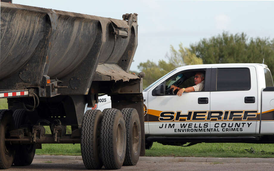 Jim Wells County environmental officer Hector Zertuche inspects trucks near Alice.  In Frio County, fracking activity is minimal but it has a big share of the area's disposal wells that accept oil-field waste water. Photo: Express-News File Photo