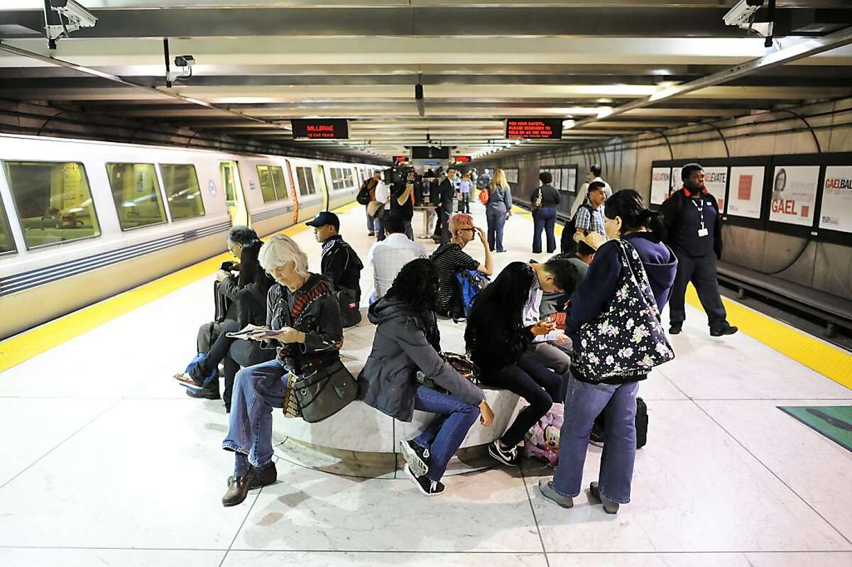 In this file photo, people wait for trains at the Embarcadero BART station.