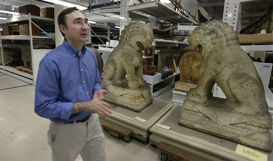 Collections manager Jamie Kelly in a new storage facility that is part of the museum's financial woes. Photo: M. Spencer Green, Associated Press