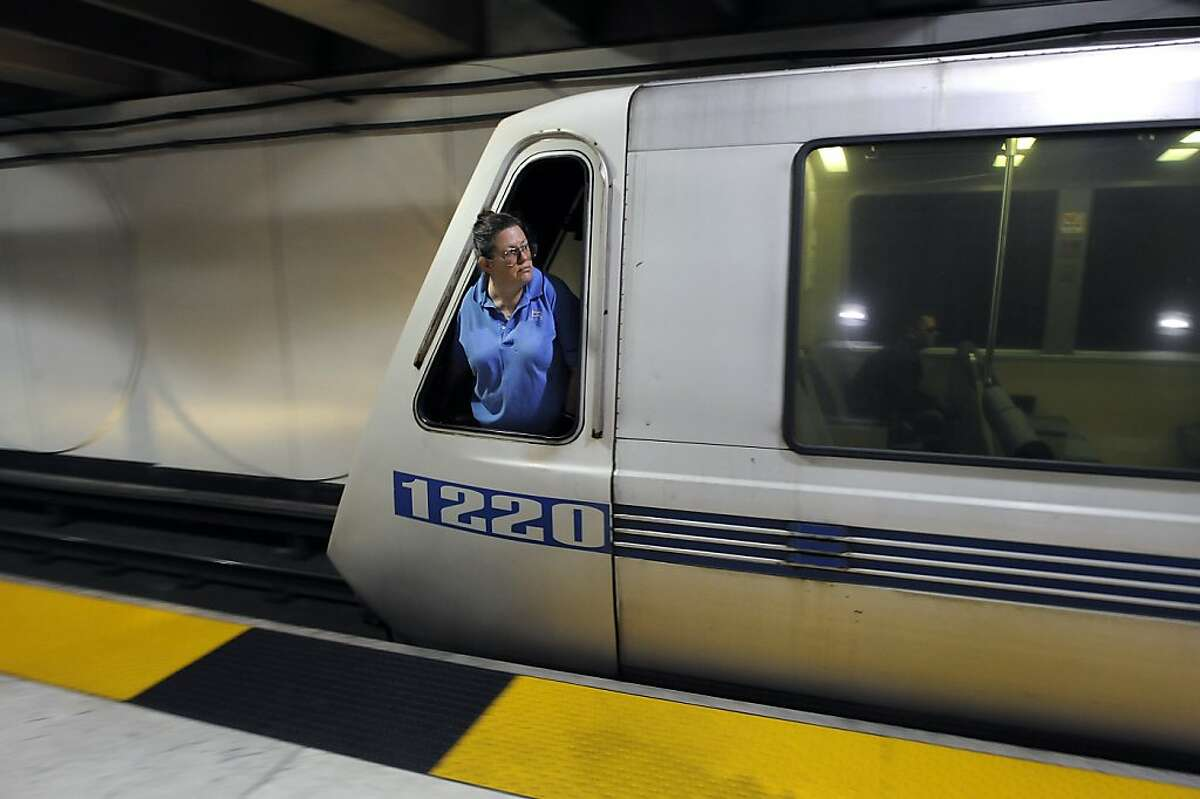 In this file photo, a train operator looks out of her window as she prepares to leave the Embarcadero station in San Francisco.
