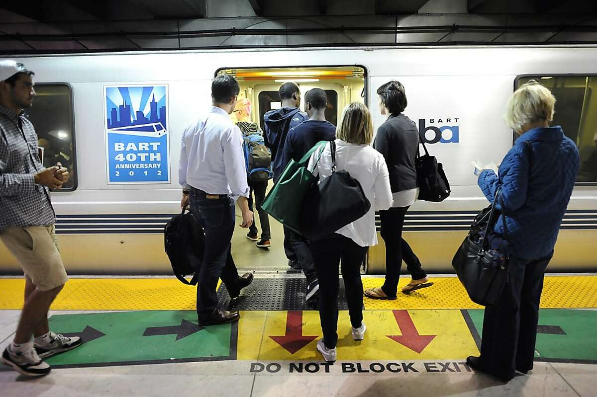 A file photo of people boarding a train at the BART Embarcadero station.