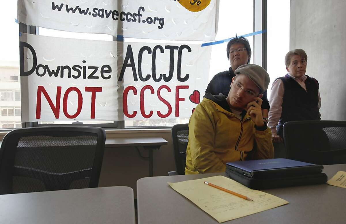 Third year CCSF student Eric Blanc, Nancy Reiko-Kato, (back left) Community supporter and Muriel Parenteau, department chair for disabled students and services, all members of the Save CCSF Coalition ?' which represents faculty, students, staff, and community members. They are rejecting the legitimacy of the Accrediting Commissions' decision to terminate the school's accreditation as they hold a press briefing at the Chinatown/North Beach campus of CCSF in San Francisco, Calif., on Friday July 5, 2013.