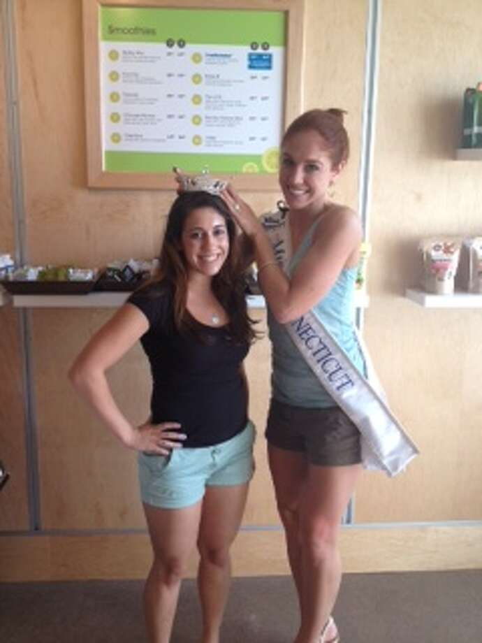Miss Connecticut Kaitlyn Tarpey (right), poses with a customer at Green & Tonic in Darien on Friday, June 28. Photo: File