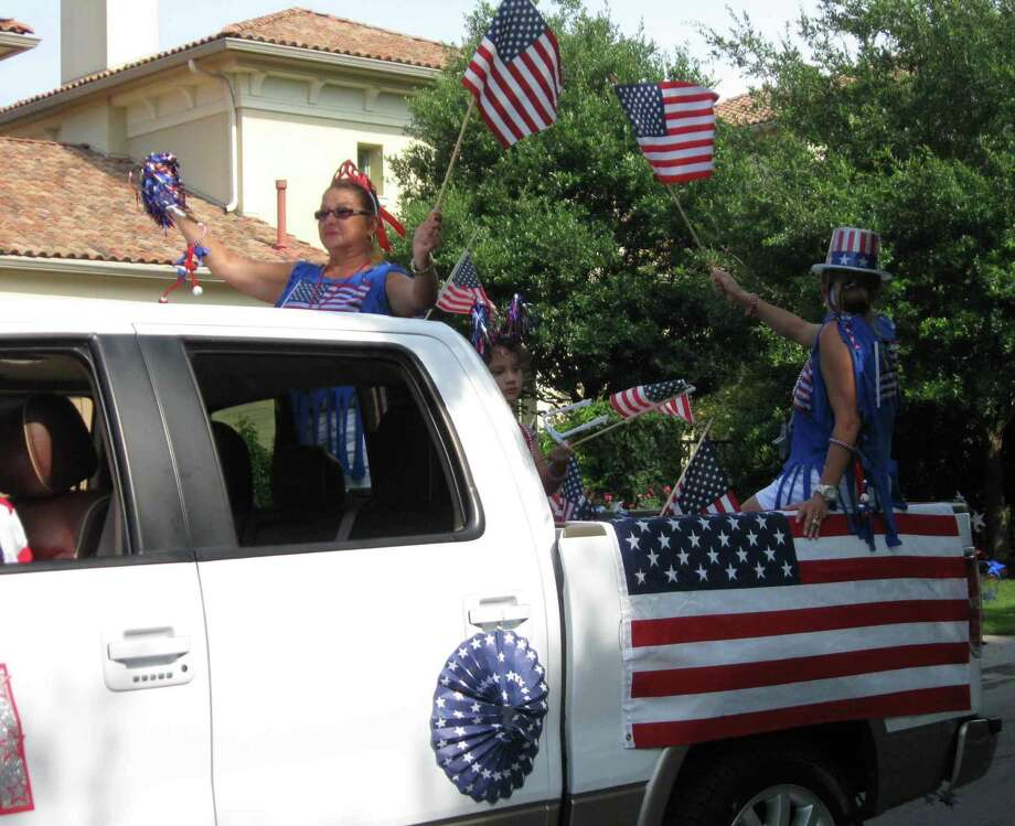 Terrell Hills residents show off their patriotic spirit during the city's Fourth of July parade, which was followed by a picnic on Geneseo Parkway. Photo: Natalie Chandler / North Central