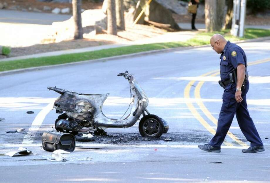 Greenwich police investigate the scene of an accident between a motor scooter and car at the corner of Valley Drive and West Putnam Avenue in Western Greenwich, Friday, July 5, 2013.