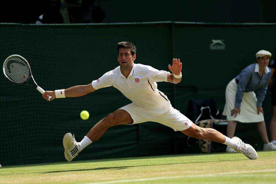 LONDON, ENGLAND - JULY 05:  Novak Djokovic of Serbia stretches to play a forehand the ball during the Gentlemen's Singles semi-final match against Juan Martin Del Potro of Argentina on day eleven of the Wimbledon Lawn Tennis Championships at the All England Lawn Tennis and Croquet Club on July 5, 2013 in London, England.  (Photo by Clive Brunskill/Getty Images) ORG XMIT: 168810739 Photo: Clive Brunskill / 2013 Getty Images