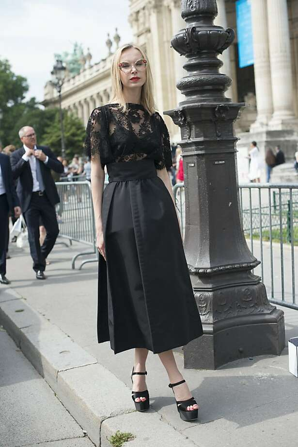 Photographer Ilona Stolie wears a Dolce and Gabbana dress, Prada shoes and Ulyana Sergeenko sunglasses on day 2 of Paris Collections: Women's Haute Couture on July 02, 2013 in Paris, France.  (Photo by Kirstin Sinclair/FilmMagic) Photo: Kirstin Sinclair, FilmMagic