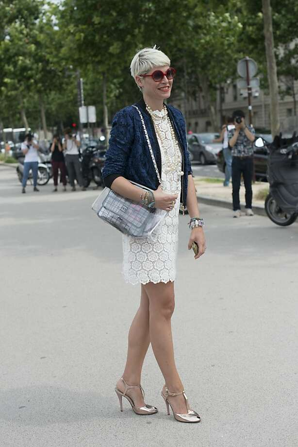 Stylist Elisa Nalin wears a Valentino dress, Jefen shoes, Chanel bag, Pinko jacket and LâWrenn Scott sunglasses on day 1 of Paris Collections: Women's Haute Couture on July 01, 2013 in Paris, France.  (Photo by Kirstin Sinclair/FilmMagic) Photo: Kirstin Sinclair, FilmMagic
