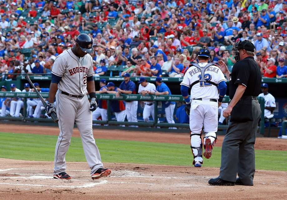 July 5: Rangers 10, Astros 5Umpire Jim Joyce looks on as Chris Carter reacts to striking out.