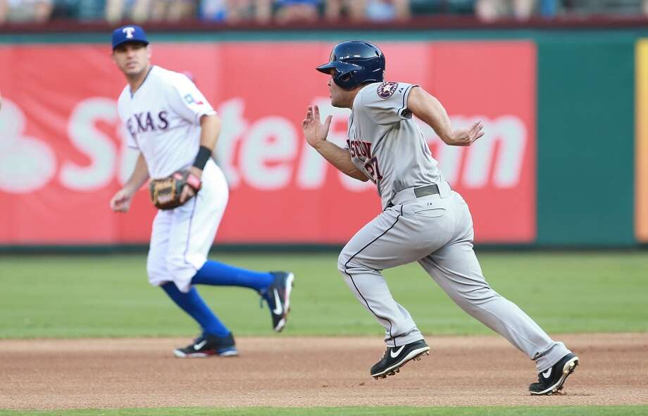 Ian Kinsler runs towards second as Jose Altuve steals the bag.