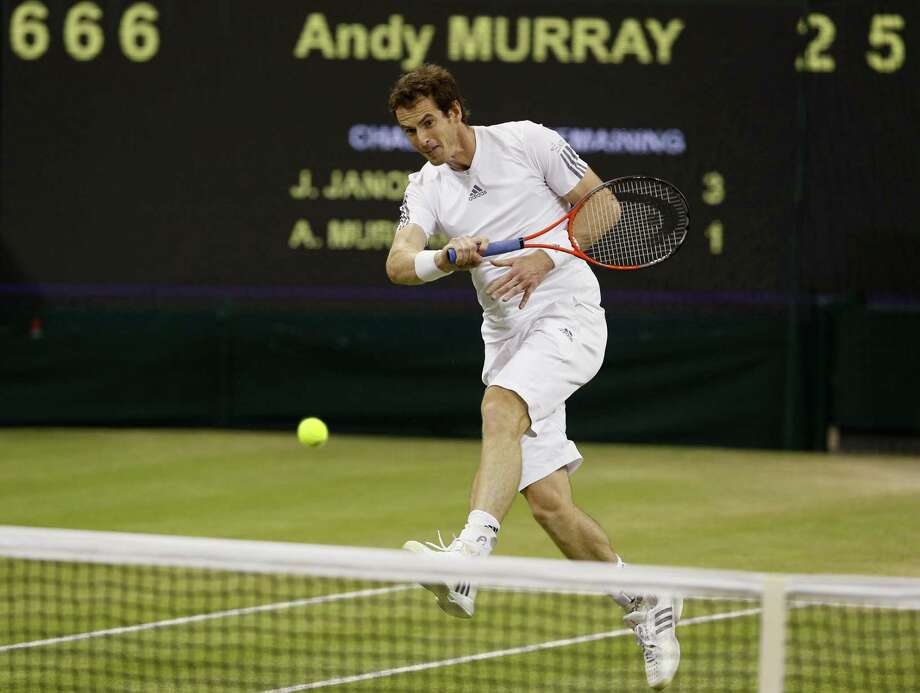 Andy Murray, who will try to become the first British man to win Wimbledon since 1936 on Sunday, hits a return to Jerzy Janowicz in his 6-7 (2), 6-4, 6-4, 6-3 semifinal victory Friday. Photo: Kirsty Wigglesworth / Associated Press