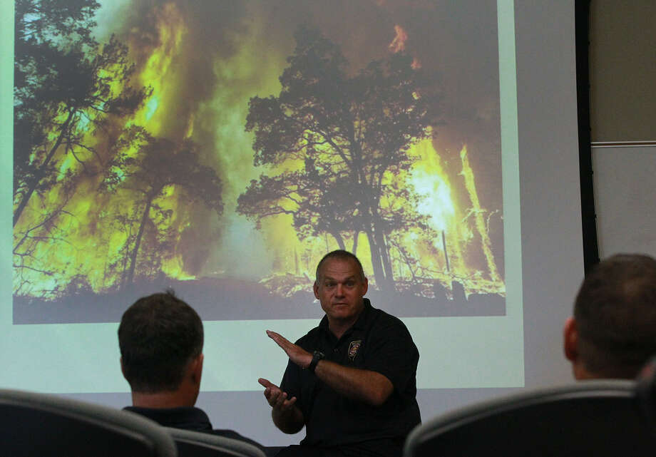 "San Antonio fire Capt. Guy Duncan — whose full-time job is making sure the department can respond to a wildfire with a coordinated, polished approach — speaks during a class called ""Fire Operations in the Wildland/Urban Interface."" It's designed to instruct firefighters how to battle brush and forest fires in areas where nature meets municipality. Photo: John Davenport / San Antonio Express News"