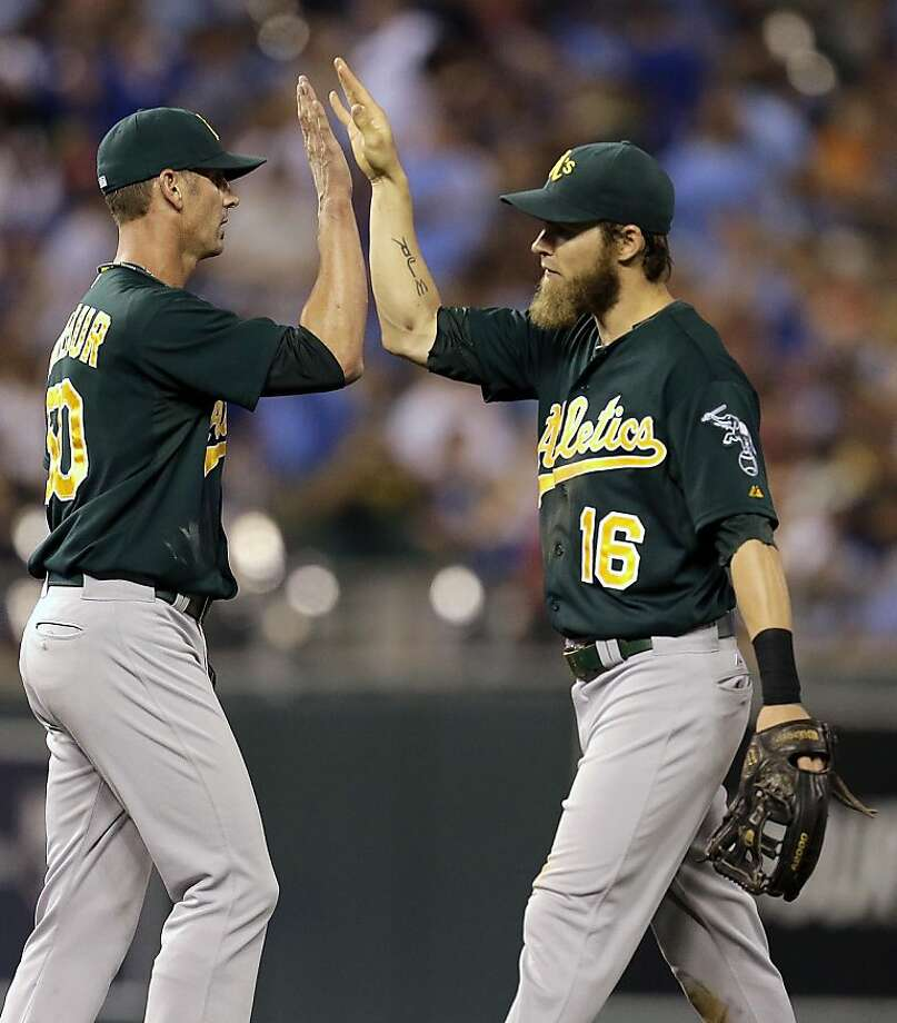 Oakland Athletics relief pitcher Grant Balfour, left, and right fielder Josh Reddick (16) celebrate after their baseball game against the Kansas City Royals, Friday, July 5, 2013, in Kansas City, Mo. The Athletics won the game 6-3. (AP Photo/Charlie Riedel) Photo: Charlie Riedel, Associated Press