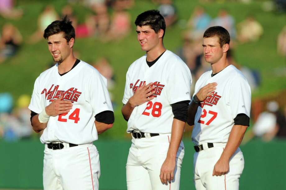ValleyCats pitcher Mark Appel, center, honors the flag during the playing of the National Anthem with teammates Adam Nelubowich, left, and Conrad Gregor during their game against Lowell Spinners on Friday, July 5, 2013, at Bruno Stadium in Troy, N.Y. (Cindy Schultz / Times Union) Photo: Cindy Schultz / 00023060A