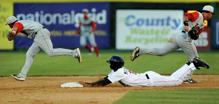 ValleyCats Ronnie Mitchell, center, slides safely into second as Lowell Spinners chalk up an error during their game on Friday, July 5, 2013, at Bruno Stadium in Troy, N.Y. (Cindy Schultz / Times Union) Photo: Cindy Schultz / 00023060A