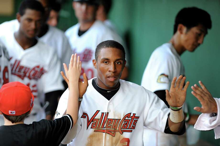 ValleyCats Tony Kemp, center, slaps high fives in the dugout after scoring a run during their game against Lowell Spinners on Friday, July 5, 2013, at Bruno Stadium in Troy, N.Y. (Cindy Schultz / Times Union) Photo: Cindy Schultz / 00023060A