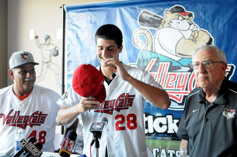Mark Appel, center, is introduced as a pitcher for the Tri-City ValleyCats Thursday afternoon, July 4, 2013, during a press conference at Joe Bruno Stadium in Troy, N.Y.  Appel was the first round draft pick for Houston. HeâÄôll pitch for the ValleyCats starting Friday night. Ed Romero, ValleyCats manager, left, and club president Bill Gladstone, right, welcomed him to the team. Will Waldron/Times Union) Photo: Albany Times Union