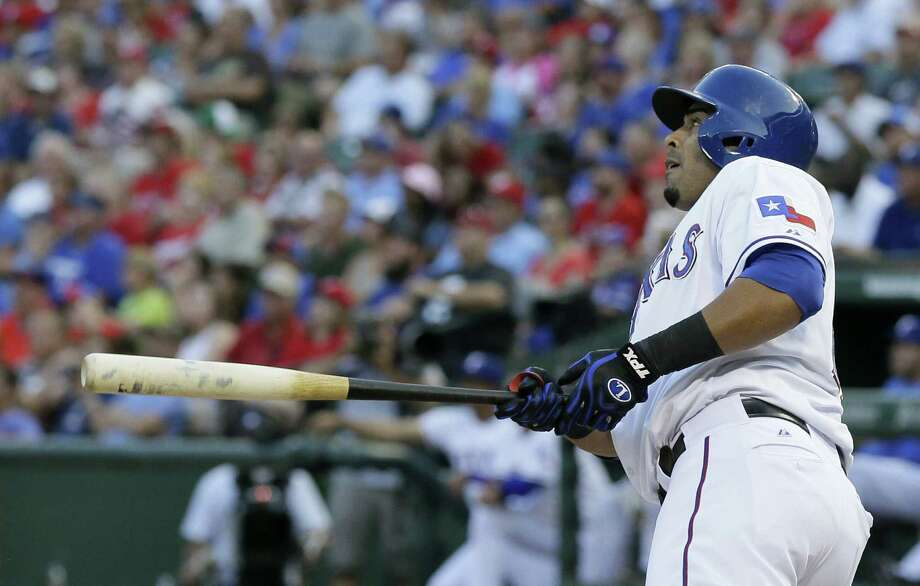 Nelson Cruz belted a grand slam to help Texas beat Houston for the 10th time in 11 games. Photo: Tony Gutierrez / Associated Press
