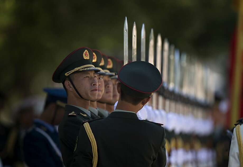 Members of a guard of honor prepare for a welcome ceremony for Pakistan Prime Minister Nawaz Sharif, unseen, outside the Great Hall of the People in Beijing, China, Friday, July 5, 2013. (AP Photo/Ng Han Guan) Photo: Ng Han Guan, Associated Press