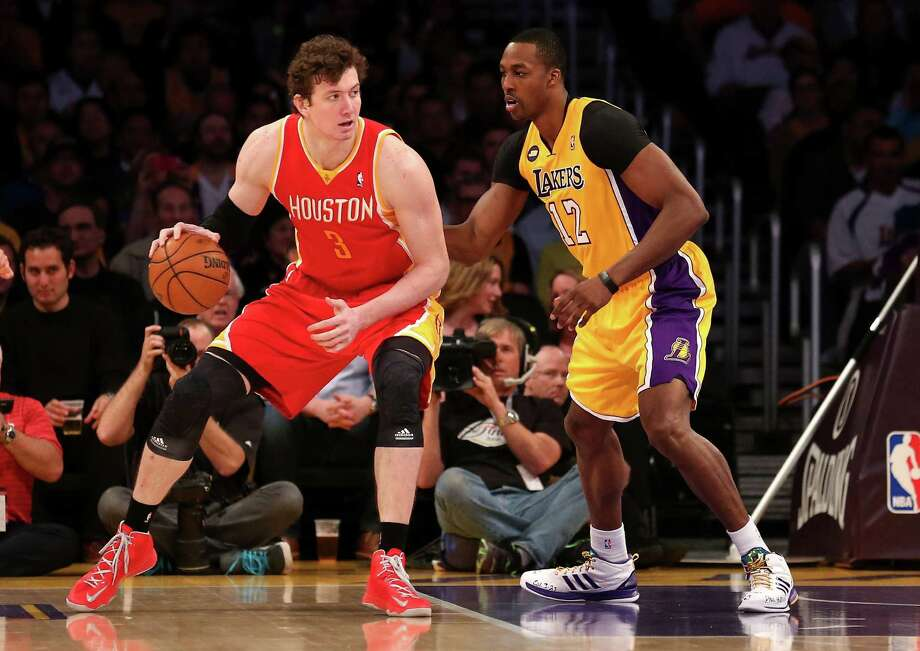 Omer Asik, left, and Dwight Howard went head-to-head in April, but that won't be the case next season when they are on tap to become Rockets teammates. Photo: Stephen Dunn, Staff / 2013 Getty Images