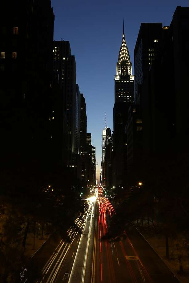 Traffic moves along 42nd Street in Manhattan with the Chrysler Building lit up, Friday, July 5, 2013, in New York. (AP Photo/Julio Cortez) Photo: Julio Cortez, Associated Press