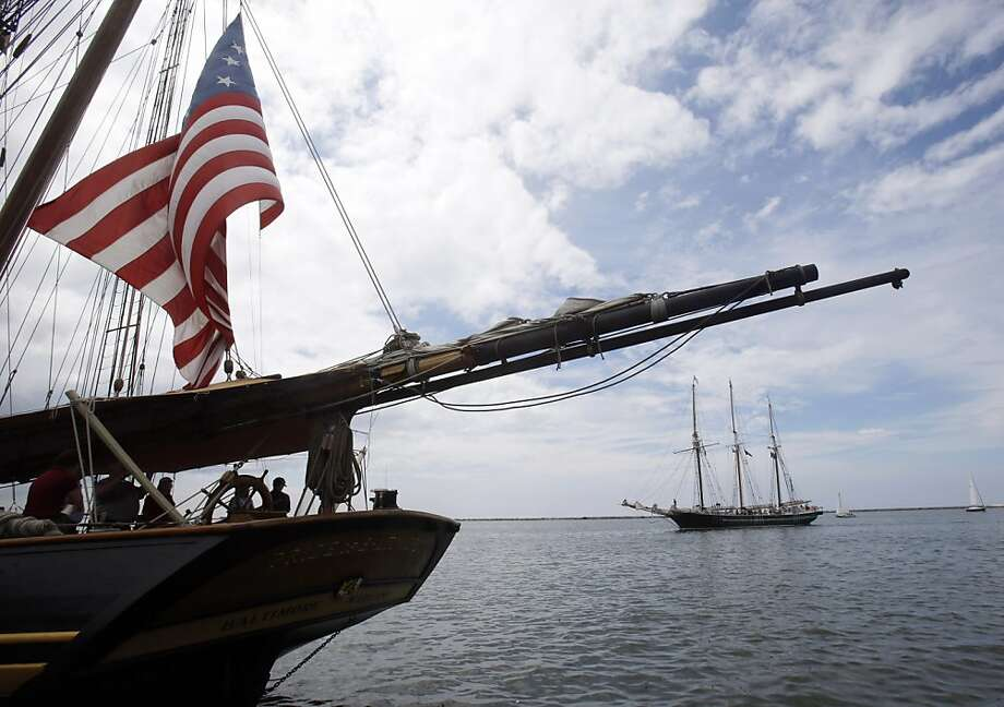 The Pride of Baltimore II, left, rests on the shores of Lake Erie as the Denis Sullivan rolls into port at the Tall Ships Festival on Friday, July 5, 2013, in Cleveland. The Tall Ships Festival runs through the weekend. (AP Photo/Tony Dejak) Photo: Tony Dejak, Associated Press