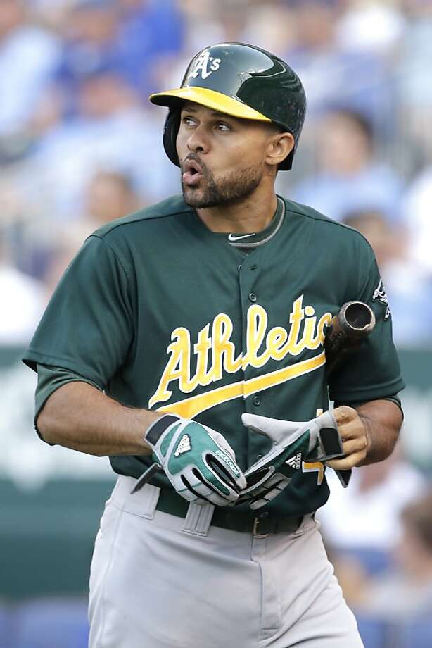 Oakland Athletics' Coco Crisp walks back to the dugout after striking out during the first inning of a baseball game against the Kansas City Royals Friday, July 5, 2013, in Kansas City, Mo. (AP Photo/Charlie Riedel) Photo: Charlie Riedel, Associated Press