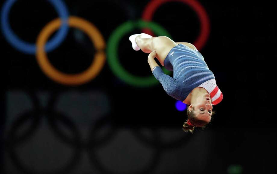 Savannah Vinsant from the U.S. performs during the women's trampoline qualification at the 2012 Summer Olympics, Friday, Aug. 3, 2012, in London. (AP Photo/Julie Jacobson) Photo: Julie Jacobson, STF / AP