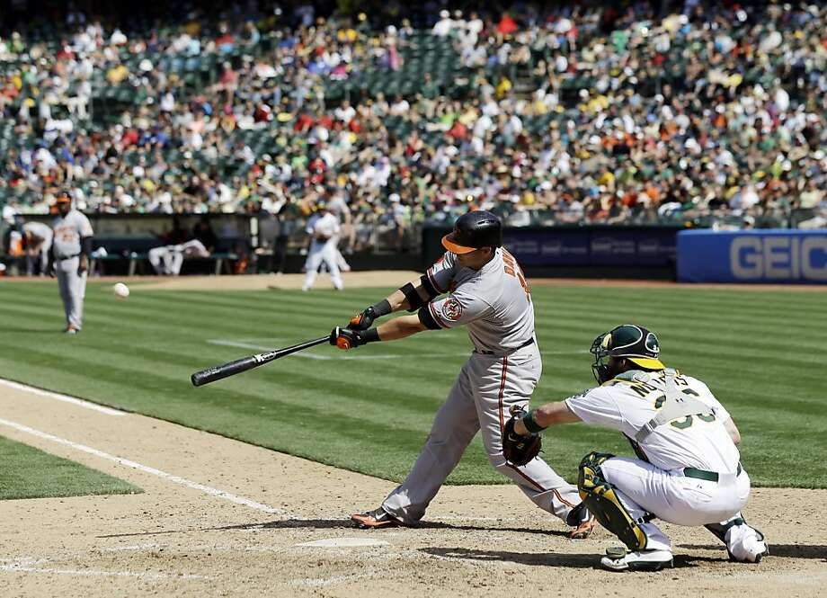 Baltimore first baseman Chris Davis is leading the majors with 33 home runs, including this one off of Sean Doolittle at the Coliseum on April 28. He is on pace for 61 homers this season. Photo: Marcio Jose Sanchez, Associated Press