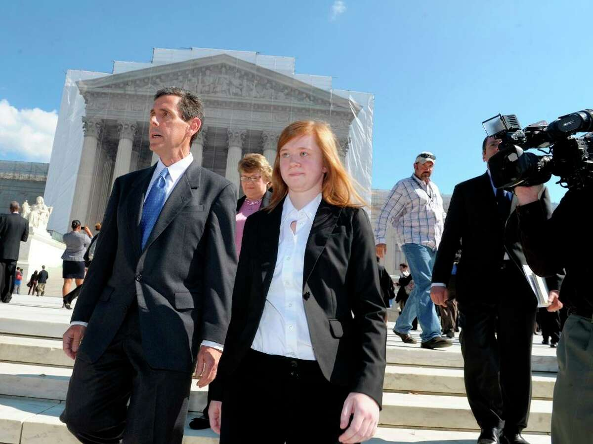 Abigail Fisher, the Texan involved in the University of Texas affirmative action case, and Edward Blum, who runs a group working to end affirmative action, outside the U.S. Supreme Court.